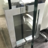 Glass door finished with high quality chrome squared handle.