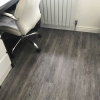 Distressed effect Karndean flooring to provide long life and soften noise.
