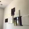 Bespoke arrangement of art panels added to opposing wall for design.